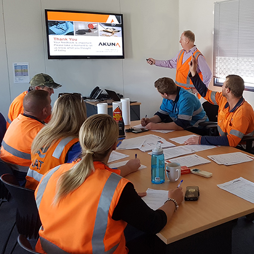 people in classroom for spill response training