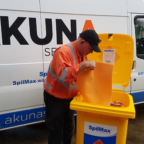 service person performing spill kit inspection and restock onsite during spill kit servicing