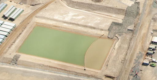 silt curtain installed in sediment pond at an LNG facility