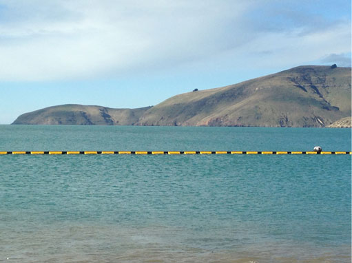 heavy duty silt curtain installed in open ocean in New Zealand