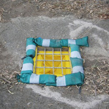 silt warden installed in stormwater pit with silt socks surrounding the grate for sediment control on construction site