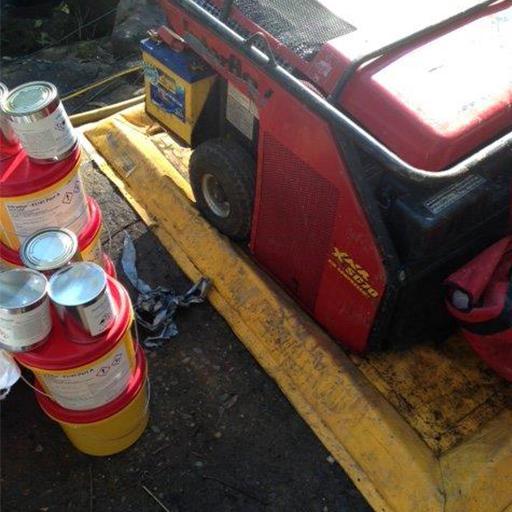 spill mat holding equipment on an outdoor work site