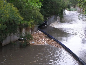 weed and debris boom in stormwater canal