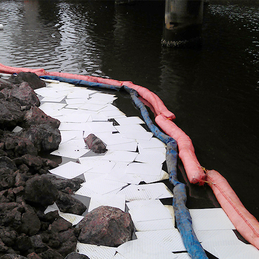 oil absorbent booms and pads being used in hydrophobic spill clean up