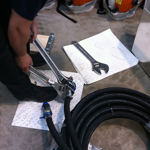 oil absorbent pads under tools and hoses