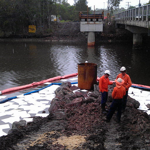 using absorbent booms pads for oil spill clean up on water