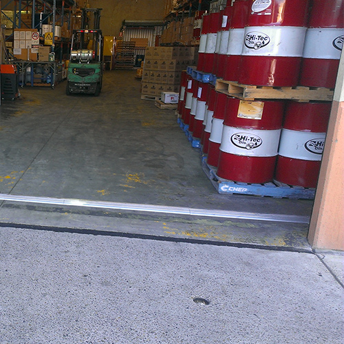 aluminium floor bunding across warehouse entry
