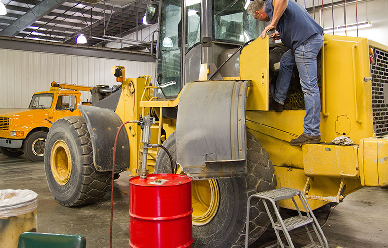 environmental solutions - depot - working on heavy equipment